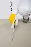 Sharp tool checking cement floor Stock Images