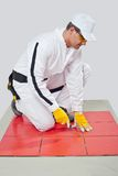 Sharp tool cleans tile joints Stock Photo