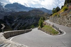 Sharp turn on a mountain road. The sharp turn on a mountain road royalty free stock photography