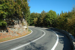 Sharp turn on mountain road Royalty Free Stock Photo