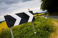 Sharp turn in the road. A sign showing a sharp corner stock images