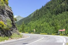 Sharp turn left on the road in the mountains royalty free stock images