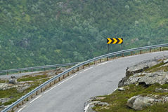Sharp turn sign Stock Photo