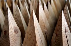 Sharp wooden posts in rows Stock Photo