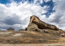 Sharp yellow stone rock in the middle of the desert Stock Photo