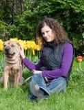 Sharpei dog with girl Stock Image