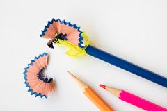 Sharpen color pencil with sharpener stock images