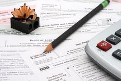 Sharpen Pencil Tax Time. Calculator tax forms sharp pencil and sharpener royalty free stock photography