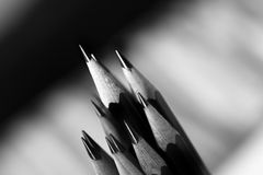 Sharpened Artists Pencils at angle. Several Sketch Pencils sharpened with fine points. Image black and white Royalty Free Stock Images