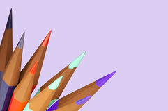 Sharpened Color Pencils on Side of Lavendar Sheet Stock Images