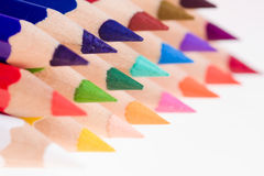 Sharpened Colored Pencils. A closeup of the sharpened tips of wooden colored pencils with a narrow depth of field and the focus on the first pencil Royalty Free Stock Image