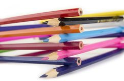 Sharpened colored pencils on the white background. Sharpened colored pencils on the white background Royalty Free Stock Images
