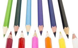 Sharpened colored pencils on the white background. Sharpened colored pencils on the white background Royalty Free Stock Photo