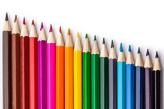 Sharpened colored pencils on a white background. Royalty Free Stock Photo