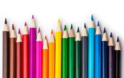 Sharpened colored pencils on a white background. Stock Image