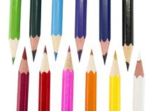 Sharpened colored pencils on the white background. Sharpened colored pencils on the white background Royalty Free Stock Photos