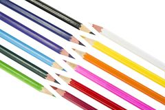 Sharpened colored pencils on the white background. Sharpened colored pencils on the white background Royalty Free Stock Image