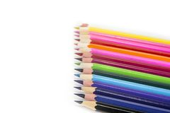 Sharpened colored pencils on the white background. Sharpened colored pencils on the white background Stock Image