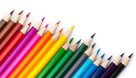 Sharpened colored pencils on a white background. Royalty Free Stock Image