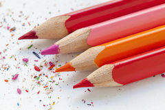 Sharpened colourful pencils on white paper. Close up Royalty Free Stock Photography
