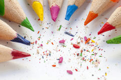Sharpened colourful pencils on white paper. Close up Stock Photography