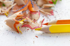 Sharpened colourful pencils and wood shavings Stock Photo