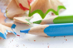 Sharpened colourful pencils and wood shavings. Close up Stock Image