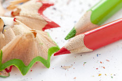 Sharpened colourful pencils and wood shavings. Close up Stock Photos