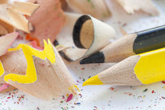 Sharpened colourful pencils and wood shavings. Close up Stock Photography