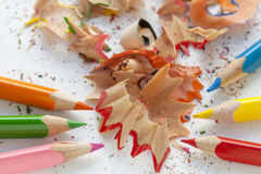 Sharpened colourful pencils and wood shavings. Close up Royalty Free Stock Photo