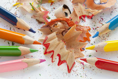 Sharpened colourful pencils and wood shavings. Close up Stock Photo