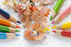 Sharpened colourful pencils and wood shavings. Close up Royalty Free Stock Photography