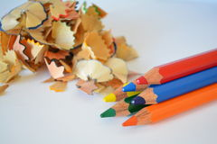 Sharpened crayons. Colored wood shavings from blunt pencils Royalty Free Stock Images