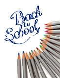 Sharpened monochrome watercolor pencils with multicolor slate-pencil on a white background and hand drawn Back to School title Stock Photo