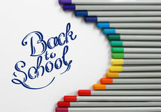 Sharpened monochrome watercolor pencils with multicolor slate-pencil on a white background and hand drawn Back to School title Royalty Free Stock Photos