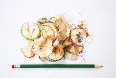 Sharpened pencil. Creative process. Wood shavings. Sharpened green pencil. Colored wood shavings Stock Photo