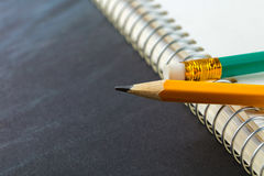 Sharpened pencil and a notebook Royalty Free Stock Photos