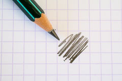 Sharpened pencil on paper. Stock Images