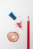 Sharpened pencil, shavings and sharpener Royalty Free Stock Photos