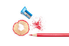 Sharpened pencil, shavings and sharpener. On a white background. Top view Royalty Free Stock Photo