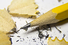 Sharpened pencil. With small pieces from it Stock Photos
