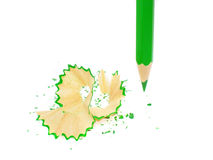 Sharpened pencil on white. Sharpened pencil and wood shavings Stock Photo