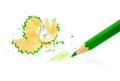 Sharpened pencil on white. Sharpened pencil and wood shavings Royalty Free Stock Image