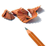Sharpened pencil and wood shavings Royalty Free Stock Photos