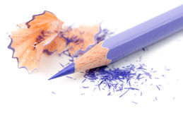 Sharpened pencil and wood shavings Royalty Free Stock Photography