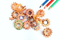 Sharpened pencil and wood shavings. On white background Stock Photography