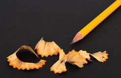 Sharpened pencil and wooden shavings Royalty Free Stock Photo