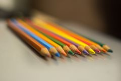 Sharpened pencils of different colors with a focus in the foreground. Colour pencils. Office tools. Office for work and study. Sharpened pencils of different Royalty Free Stock Images