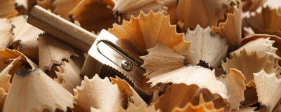 Sharpened pencils, sharpener and wood shavings - Banner/Header edition Stock Images