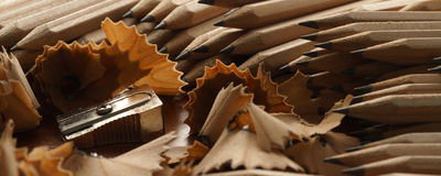 Sharpened pencils, sharpener and wood shavings - Banner/Header edition Stock Image